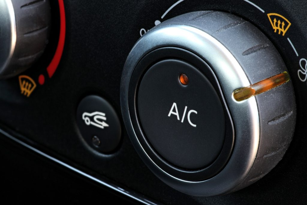 close up on car interior AC air conditioning dial